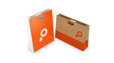 Paper carrier bags with die cut handles